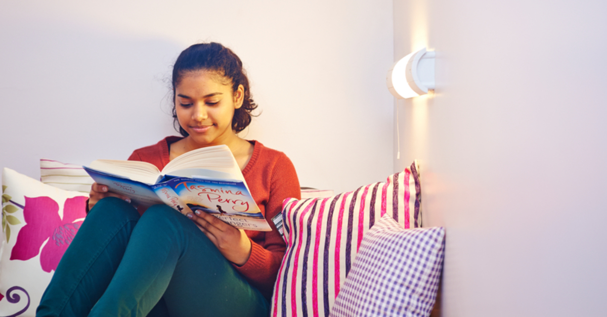 Student_Sat_In_Bed_Reading