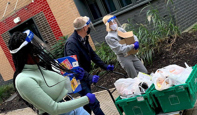 NUSU President, Dorothy Chirwa and Vice-Chancellor and President, Prof Chris Day help deliver food parcels to our students