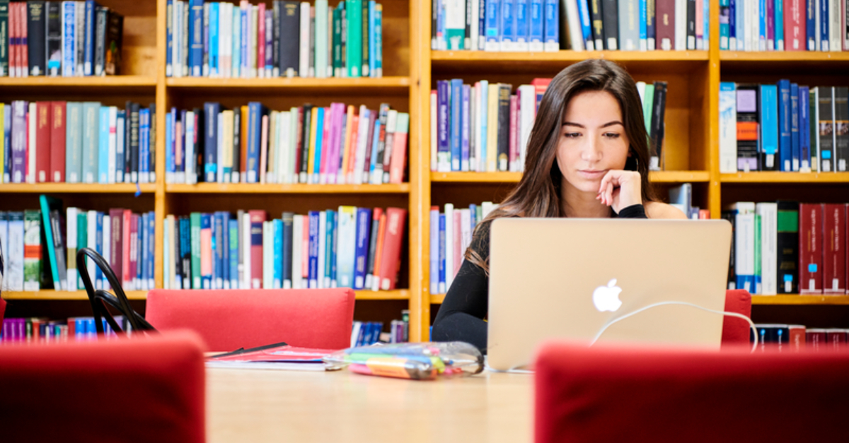 How_to_revise_for_essay_exams_girl_student_studying_in_library